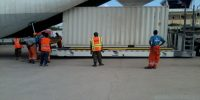 Heavy loader loading UN container